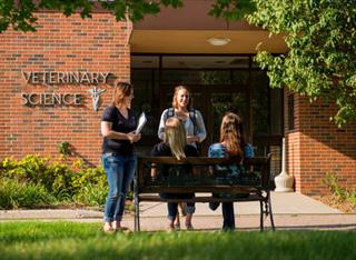 South Dakota State University students gather outside the veterinary science building